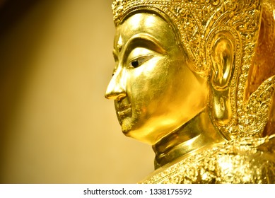 decoration god face golden sculpture thailand buddha religion bangkok temple asia buddhism thai travel wat culture asian traditional buddhist tourism architecture landmark art statue background gold
