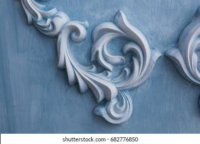 decoration item made of blue plaster. relief stucco interior