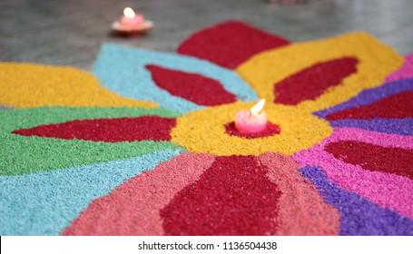 Decoration of Kolam, preparation for Diwali or Deepavali celebration (festival of lights)