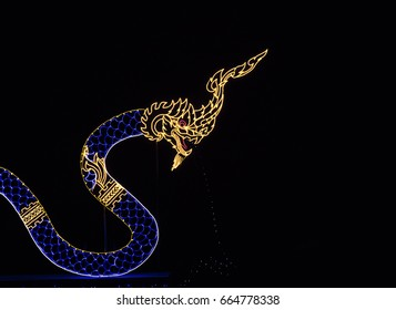 decoration led light show serpent in middle of pond , led shape of king of snake with reflection on water