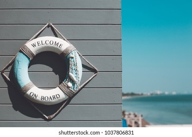 """Decoration life ring with """"Welcome aboard"""" word decorate on wall"""