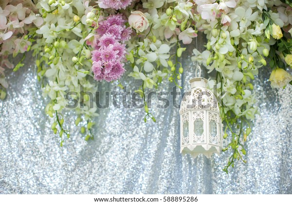 Decoration made of lamps with flower on backdrop for wedding party