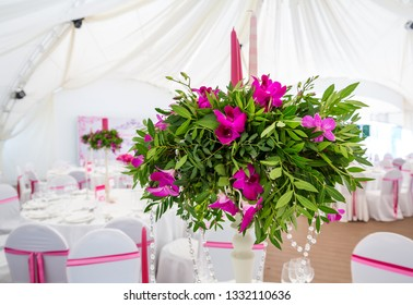 Decoration with natural flowers and candles closeup for wedding to celebrate the event in the restaurant