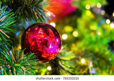 Decoration on Christmas day with red ball hanging on chrismas tree.
