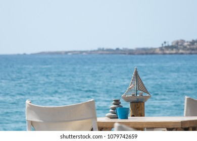 The decoration on the table overblu sky and sea background. Sammer holiday concept
