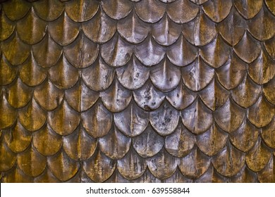 Decoration on wood, dragon scales