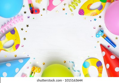 Decoration for the party on wooden white background. Top view. Space for text.