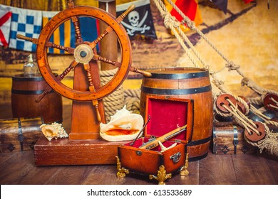 Decoration of the room in a pirate style, with a helm and a treasure chest