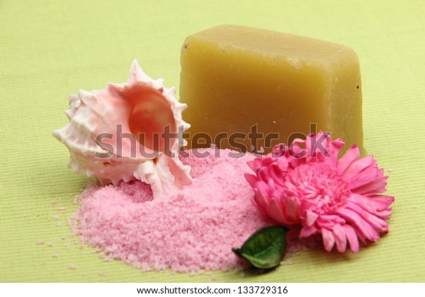 Decoration of sea salt, a beautiful sea shells and pink flower for spa treatments and relaxation
