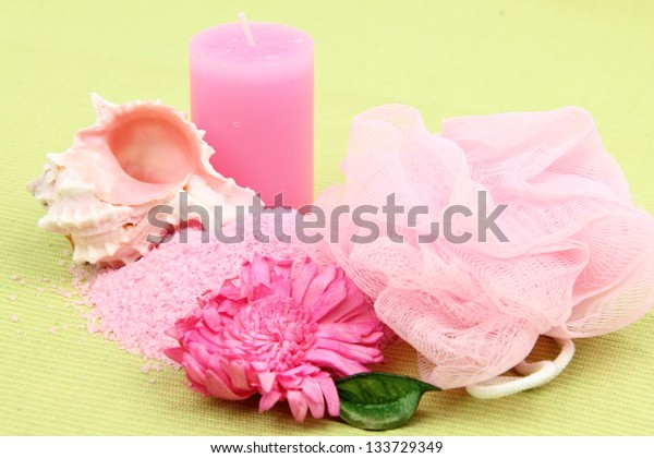 Decoration of sea salt, a beautiful sea shells and pink flower on summer vacation and spa