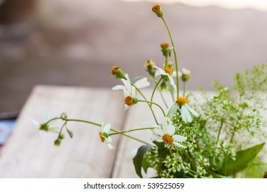 Decoration with small flowers on wood