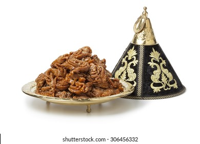 Decoration tajine with fresh baked chebakia for ramadan on white background