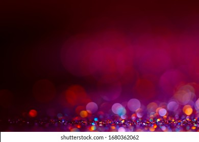 Decoration twinkle lights background, abstract sparkle backdrop with circles,modern design overlay with sparkling glimmers. Purple, red, pink and black backdrop glittering sparks with blur effect