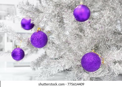 Decoration ultraviolet colored baubles on silver artificial Christmas tree, it's trending color of 2018