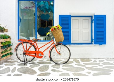 The decoration of vintage orange bicycle and white building