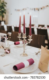 Decoration for a wedding table with pink candles
