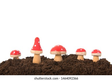 Decoration with wooden mushrooms red with white dots