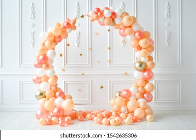 Decorations for holiday party. A lot of balloons orange and white colors.