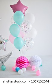 Decorations for holiday party. A lot of balloons pink blue and white colors.