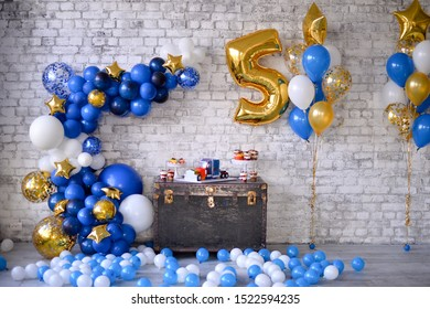 Decorations for holiday party. Birthday decorations ideas. A lot of balloons blue and white colors.