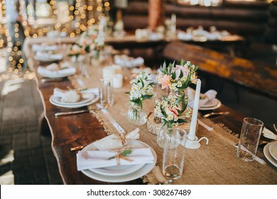 decorations made of wood and wildflowers served on the festive table