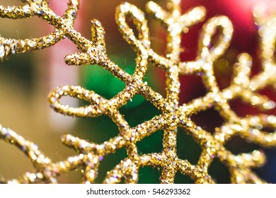 Decorations for New Year and Christmas tree. They are made of glass, plastic and sequins. They're on a different color. Some reflect, while others are translucent.