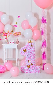 Decorations on birthday. Pink and white balloons.