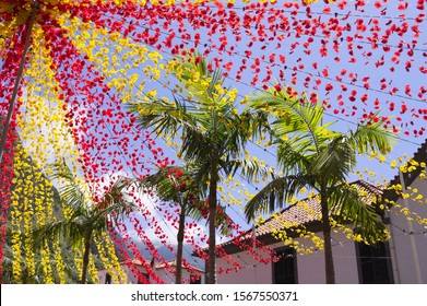 Decorations with red and yellow colored paper flowers in the square for a traditional festival (Sao Vicente, Madeira, Portugal)
