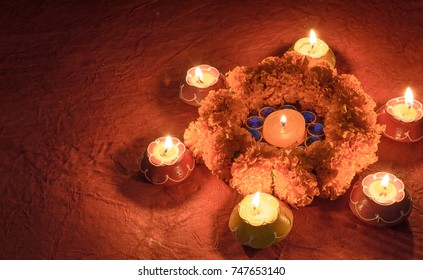 Decorations with traditional Indian oil lamps and marigold flowers with selective focus.