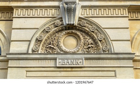 Decorative Arch And Keystone Above The Door Of A Bank, shallow depth of field horizontal photography
