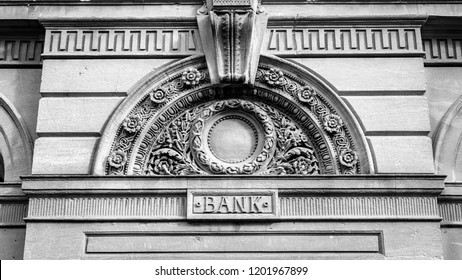 Decorative Arch And Keystone Above The Door Of A Bank BW, shallow depth of field horizontal black and white photography