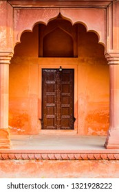 Decorative archways of the red sandstone buildings surrounding t
