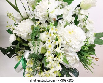 Decorative artificial white flowers in vase