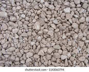 Decorative background with coating of stone rubbles. Irregular size broken stone, shape and texture, for road coat.