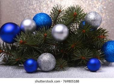Decorative background with fir branches and balls on the silver. Christmas card Holiday Concept