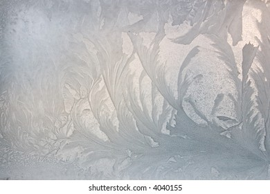 Decorative background with ice patterns at a window.