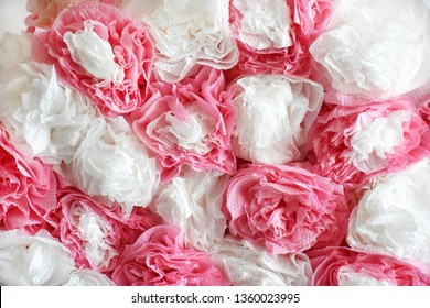 Decorative background of white and pink napkins in the form of flowers.