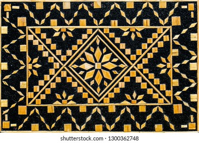 Decorative background of wooden mosaic pattern