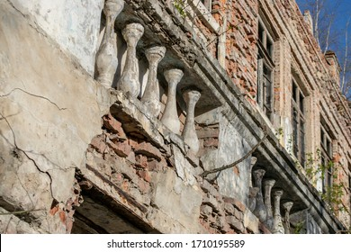 Decorative balusters of an old abandoned estate. Vintage balusters on the facade closeup