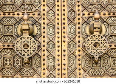 Decorative and and beautiful golden door with knockers in Morocco, Africa