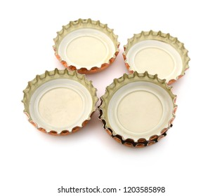 Decorative beer caps on white table