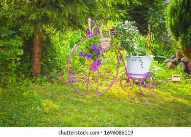 Decorative bicycle with flowers in the garden