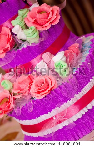 Decorative Cake Made Of Flowers And New Babe Borns Accessories