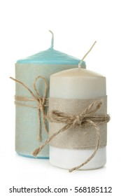 Decorative candles on a white background isolated.