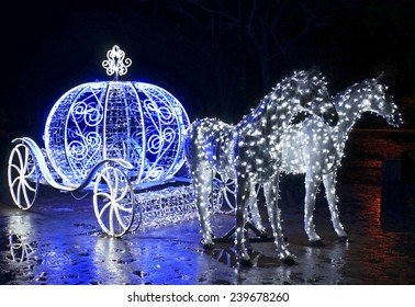 Decorative carriage with horses decorated with lights