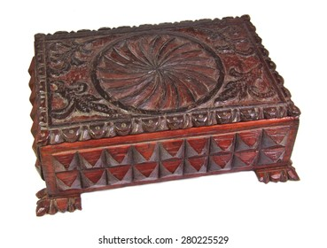 Decorative carved wood box isolated on a white background