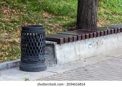 decorative cast iron black rubbish bin in the park. Vintage trashcan