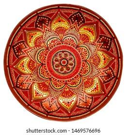 Decorative ceramic dish with hand-painted ornament. Art, handmade