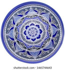 Decorative ceramic dish painted with hands. Art, handmade. Pattern mandala