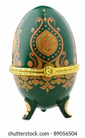 Decorative ceramic easter egg for jewellery (Faberge egg) against white background.